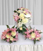Bridal & 2 maids bouquet with roses, orchids & alstromeria.