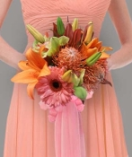 Clutch bouquet of gerbera, lilies, protea, & cymbidium.
